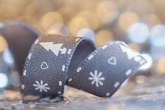 Bokeh (haberlea) Tags: home bokeh christmas ribbon macro macromonday memberschoicebokeh memberschoice mettychristmas light gentle fabric grey sparkles