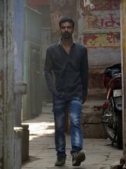 in the alleys of Varanasi (gerben more) Tags: alley man handsomeman beard varanasi benares youngman jeans india people portrait