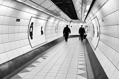 Opposite Directions (Douguerreotype) Tags: london people monochrome subway blackandwhite tube uk underground british urban mono city tunnel britain metro bw gb england