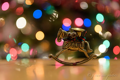 """Good tidings we bring...."" (j van cise photos) Tags: goodtidings wewishyouamerrychristmas bronze horse candleholder rockinghorse bokeh christmaslights decoration happyholidays happynewyear light holiday present joyeuxnoël ¡feliznavidad schöneweihnachten merrychristmas"