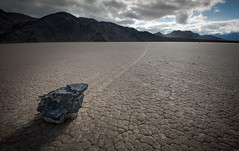 Sailing Stone ......Death Valley (Ryan Gardiner) Tags: moon leadinglines shadow nationalpark california usa racetrackplaya desert dry arid deathvalley stone cracked pointing oddity track trail reptileskin perfectgeometryforamovingrock