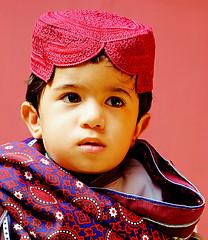 A boy in Sindhi cultural dress (tariqkhajar) Tags: street photo photography nikon portrait sindh sind larkana larkano sindhi pakistan caltural ajrak topi beautiful kid kido honey afrasayab tariqkhajar khajar morio