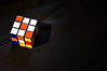 Rubik Imperfection (fotoservice18) Tags: minimal coloured sign cube cubik point view indoor creations black light game impact colour 2 directions visual design mind abstract lines shadows white old gioco di intelligenza