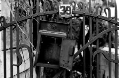 39 (Nikos.K.) Tags: 2017 athens greece gate postbox damaged blackandwhite olympusom2n zuiko 50mm18 film expired ilfordfp4 homebrewdeveloper d76