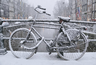 A wet brush of snowflakes on the bicycle