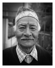 Nepali gentleman (posterboy2007) Tags: nepal nepali outdoors monochrome kathmandu portrait bw gentleman senior hindu