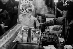 Here? Walnut bun lady II (hej_pk / Philip) Tags: fujifilm fuji fujixa1 xa1 fujinon 35mm525mm fujinonxf35mmf2wr xf35mmf2wr svartvit gatufoto blackandwhite monochrome bw bwsv gwangju kwangju sydkorea marknad market vendor seller streetfood streetcart walnut test steam vapor vapour smoke fujinonxf35mmf2rwr
