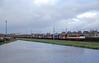 20171228 RFO 1831 + leeg staal, Heemskerk (Bert Hollander) Tags: heemskerk hk railforceone loc 1831 eloc locomotief serie 1600 oranje exlocon 9904 staalwagens shimmns blauw bruin zeildoek caib vtg goederentrein cargo rfo rrl trein 63103awhvbvhc