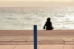 Lonely girl... (Pier Romano) Tags: girl ragazza sola lonely mare sea vento wind donna woman nizza nice francia france nikon d5100
