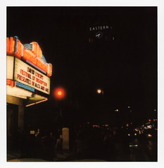 Disruption Marquee 4 (tobysx70) Tags: polaroid originals color 600 instant film slr680 frankenroid sx70 door rollers sonar marquee festival of disruption the theatre at ace hotel broadway dtla los angeles la california ca neon sign illuminated lit night nocturnal united artists david lynch movie theater cinema concert venue eastern columbia clock tower skyscraper red traffic light toby hancock photography