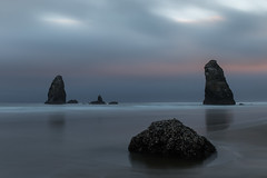 The Needles at Cannon Beach during sunset (Tim&Elisa) Tags: usa oregon pacificocean ocean cannonbeach canon landscape nature water longexposure sunset clouds theneedles reflection
