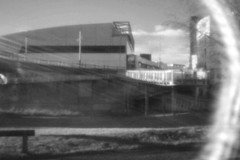 (Delay Tactics) Tags: sheffield digital pinhole ponds forge international sports centre siv venues architecture building black white bw flare sky clouds grass bench sun light sunlight rays holga hplc