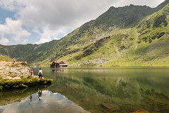Ruminating on Romania (Denis Moynihan) Tags: landscape mountain lake chalet sky cloud summer people tourists travel nature transfăgărășan transfagarasan pass dn7c ceaușescus folly ceausescu carpathian mountains romania