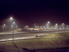 By the motorway, at night. (wojszyca) Tags: fuji fujica gsw680iii 6x8 120 mediumformat 65mm sujinon sw kodak portra 100t tungsten expired epson v800 night longexposure parking lot motorway road trucks