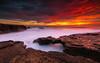 Between heaven and hell (marcolemos71) Tags: seascape water waves rocks rockbridge sky clouds sunset dusk burningsky longexposure leefilters caboraso cascais marcolemos