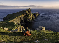 Neist Point - one man and his dog (cliveg004) Tags: neistpoint skye isleofskye scotland sea cliffs lighthouse sunset dog monty rocks waves nikon d5200 ruckenfigur mpt597 matchpointwinner
