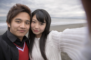 High school student couple taking selfie picture on beach