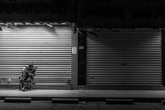 Lonely Cold Night (LensReady) Tags: blackwhite monochrome night cold rest sat safedoor locked lighting street streetphotography nightphotography handheld fullframe primelens