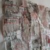 Showdown - detail (Ines Seidel) Tags: newspaper texture altered paper paperart fiberart machinestitching sewing stitching redthread news