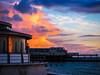 Fiery Clouds over Aberystwyth Pier (TommoSnaps) Tags: clouds wales uk aberystwyth sunset reflection pier seaside coast sky landscape
