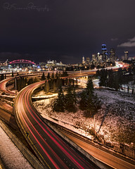 White Christmas At Seattle (Paul Scearce) Tags: seattle washingtonstate citylights christmas freeway lighttrails cityscape nightphotography nightlights longexposure skyscrapers transportation