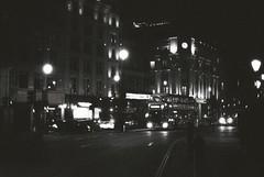 London (goodfella2459) Tags: nikon f4 af nikkor 50mm f14d lens kodak trix 400 35mm blackandwhite film analog london night city streets road bus cars traffic lights clock bwfp