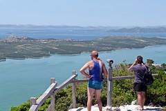 Tourists admire the coastal view (Elvis L.) Tags: kamenjak vrana viewpoint lake naturepark water sea landscape adriatic dalmatia croatia sky telescope islands