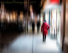 Late Night Walk (HSS) (13skies) Tags: hss slidersunday blurred blureffect downtown nighttime nightshot night coat colder weather sidewalk stores storefronts shopping alone lights effects photoshop elements sony happyslidersunday glass bambootablet layermask red