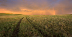 Fleeting Light (Erik Johnson Photography) Tags: nebraska sandhills storm rainbow national geographic leading lines sunset clouds ranching ranch oshkosh west goldenhour grasslands prairie