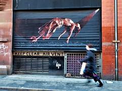keep clear air vent (LozHudson) Tags: manchester fuji xt10 fujifilmxt10 people streetart graffiti street streetphotography northernquarter running blur