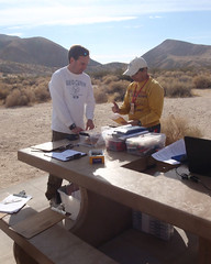 005 Clare Sets Up Registration (saschmitz_earthlink_net) Tags: 2017 california orienteering redrockcanyon statepark laoc losangelesorienteeringclub mojavedesert desert kerncounty elpasorange