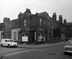 Negative No: 1968-2196 - Negatives Book Entry: 19-09-1968_Estates_Sycamore Street Cheetham_Shops etc Notice to Treat (archivesplus) Tags: manchester england 1960s townhallphotographerscollection davids barbers shop 624vc ford anglia fordanglia van cars morris