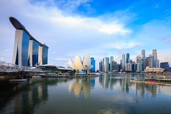 Singapore city skyline at the Marina bay during sunrise (Patrick Foto ;)) Tags: architecture asia asian bay blue buildings business city cityscape dawn day district evening famous financial harbor landmark landscape location marina metropolis modern morning museum night panorama panoramic place reflection scene scenery scenic science sea singapore sky skyline skyscrapers southeat sunlight sunrise sunset twilight urban view warm water sg