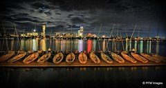 Boston at Night (pandt) Tags: boston mit mitsailingpavillion boathouse sailboat night cambridge sailing longexposure water sky clouds lights red green outdoor river charlesriver canon eos 7d slr boat boats dock float light