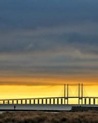 Urban Beach Walk (mikkelfrimerrasmussen) Tags: bridge suspension goldenhour clouds cloudscape urban beach strand kastrup
