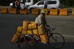 DSC_5315 (Kent MacElwee) Tags: burma myanmar yangon rangoon mandalay asia sea southeastasia carton man bike bicycle