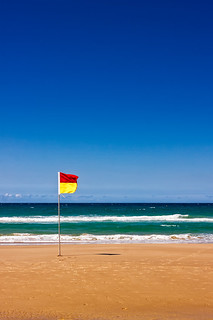 Lonely Life Saver Flag On Australian Beach
