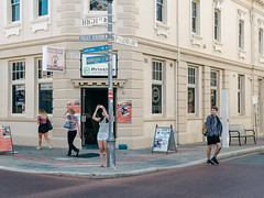 High Street and Packenham Street, Fremantle, WA (Peter.Bartlett) Tags: vsco bag women woman wall australia walking city doorway urbanarte urban streetphotography cellphone standing lunaphoto man girl olympuspenf candid poster m43 kodakportra160emulation mobilephone peterbartlett people sign microfourthirds corner facade fremantle westernaustralia au