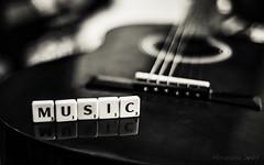 Music..... (Himanshu Joshi Bangalore) Tags: silver efex pro lightroom nikon d610 digital nikkor 50mm artistic blackandwhite monochrome bw guitar music scrabble