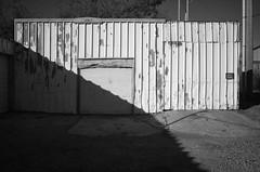 OKC - Garage Door (James Meeks) Tags: ricohgrii ricoh garage shadows bw blackandwhite oklahoma oklahomacity rust decay corrugated metal door