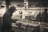 Finding that one (KevinHillPhotography) Tags: records record austin black white bw sepia tone sepiatone hat potrait music texas tx window store vintage classic old oldschool country jazz blues psychedelic sound