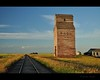 6:00 pm (Gordon Hunter) Tags: 6 six pm evening prairies grain elevator tall old abandoned building red paint pool no 834 decay derelict fading engine shed silo bin railway traintracks rail tracks shadow grass rural country outdoor dankin sk saskatchewan canada gordon hunter nikon d5000