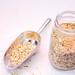 Hemp Seeds in a Spoon and Jar