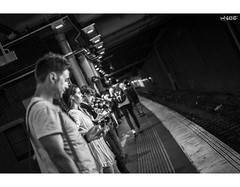 Distracted (red stilletto) Tags: melbourne flindersstreet flindersstreetstation train platform trainplatform passengers waiting phones iphone