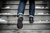 355/365 - Homeward Bound (Jacqueline Sinclair) Tags: legs feet boots fluevog fluevogs svenska vancouver steps run snow porch jump bound jeans