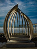 The Shell Chapel (Steve Taylor (Photography)) Tags: tinyhuts shellchapel steps art architecture sculpture carving shed blue brown wooden newzealand nz southisland canterbury christchurch newbrighton beach ocean pacific pier sea waves winter sunny cloud sky