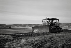 Bulldozer, Washington (austin granger) Tags: bulldozer washington palouse field farming topography land transformation soil evidence crop fallow stark cultivated transformed bleak rural track winter film gw690
