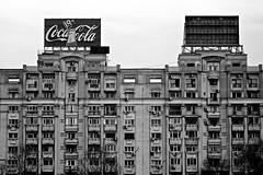 Bucharest (Rosetta Bonatti (RosLol)) Tags: bucarest bucharest bucuresti romania rosettabonatti roslol bw architecture architettura pubblicità commercial cocacola blackandwhite biancoenero facade finestre windows