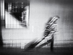 traveler (Sandy...J) Tags: olympus blackwhite bw black blur blurred street streetphotography sw urban monochrom motion fotografie photography walking walk white art germany deutschland noir bewegung verschwommen verwischt strasenfotografie stadt city frau wall wand monochrome movement