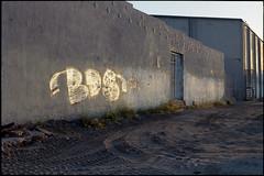 Writing on the wall (ADMurr) Tags: cbc576 la eastside construction site textured ground stucco wall stabilizing rods evening leica m4 kodak ektar 50mm summicron